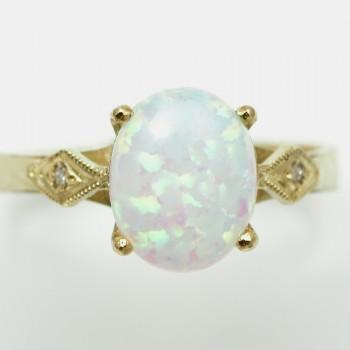Zlatý prsten s opálem